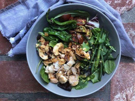 Flambeaux Mix with chicken, greens on brick ground